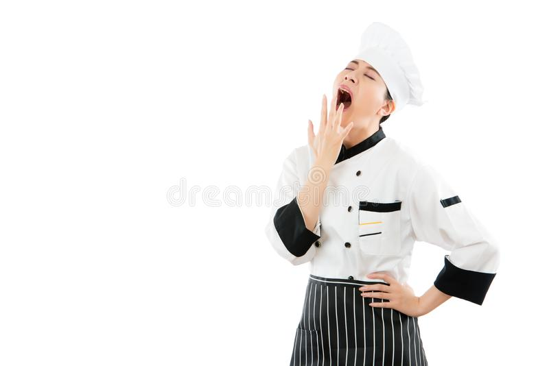 Sensación soñolienta del cocinero de la mujer cansada fotografía de archivo libre de regalías