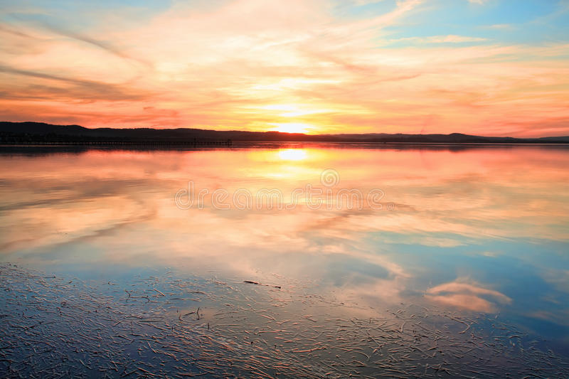 Sensational sunset at Long Jetty NSW Australia. Magnificent sunset and water reflections at Long Jetty, NSW Australia stock photography