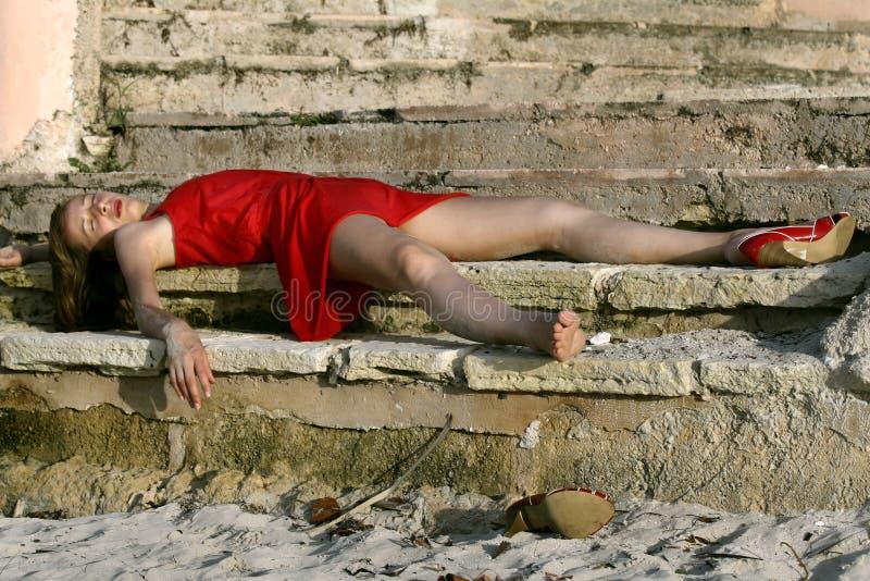 Senseless woman on the floor royalty free stock photos