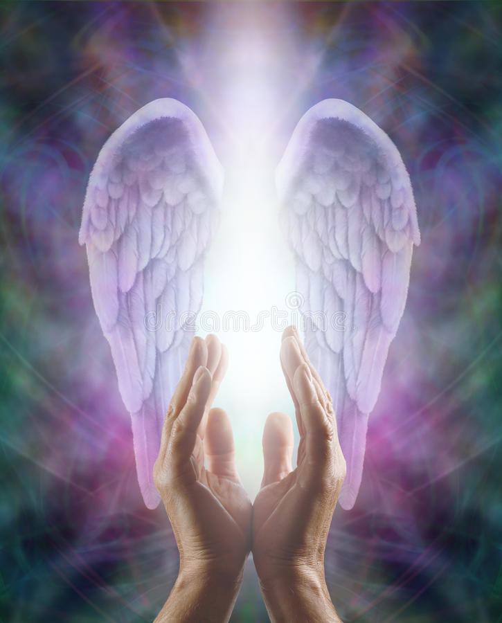 Sensing Angelic Energy. Male hands reaching up into a beautiful pair of lilac Angel wings with white light flowing down between, an intricate multicolored energy stock images
