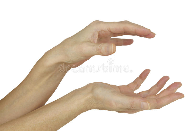 Sensing the electromagnetic energy between hands. A pair of female hands demonstrating the position for sensing the body`s natural electromagnetic field isolated stock images