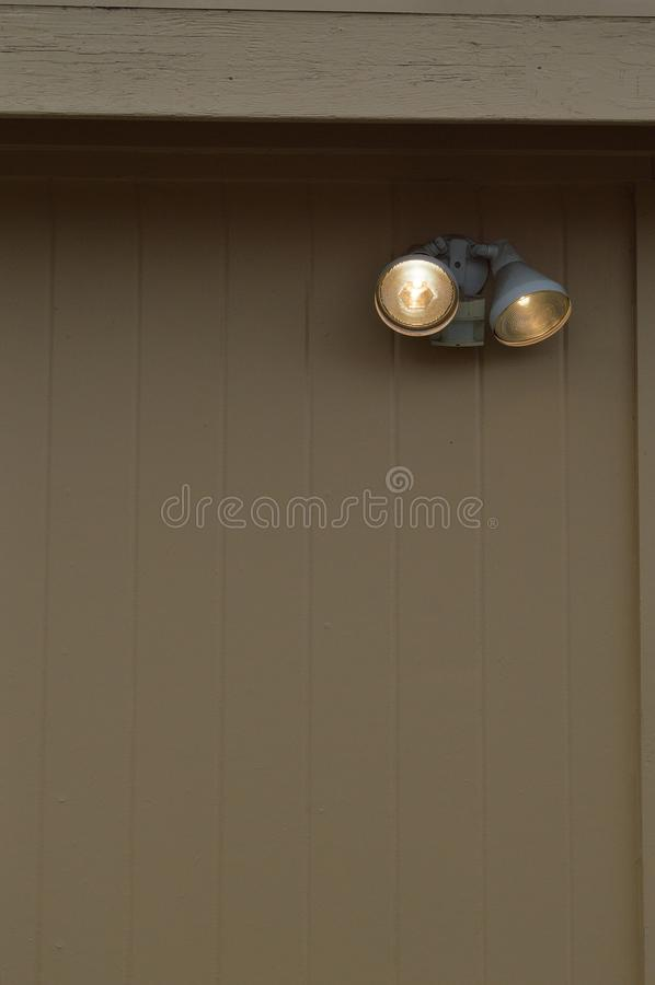 Sensitive motion-detecting outdoor security light royalty free stock images