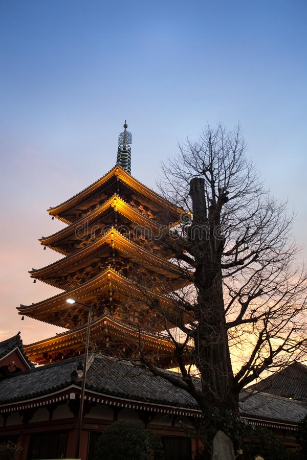 Senso-Ji Temple, Asakusa, Tokyo, Japan. Dusk at Senso-Ji temple, with one of its pagoda in the foreground and the sunset on the background. One of few Buddhist stock image