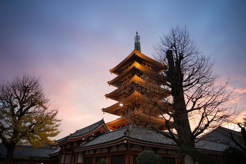 Senso-Ji Temple, Asakusa, Tokyo, Japan. Dusk at Senso-Ji temple, with one of its pagoda in the foreground and the sunset on the background. One of few Buddhist stock photo