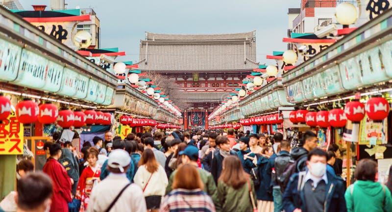 Senso-ji Temple and Nakamise Street in Asakusa. Tourists flocking to Senso-ji Temple and Nakamise shopping street in Asakusa district royalty free stock image