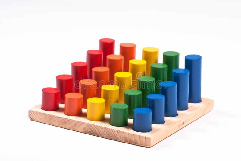 Sensory Toy: Bright Multi-Colored Cylinders on Base royalty free stock images