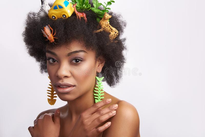 Sensual afro american lady with animals hairstyle royalty free stock photo