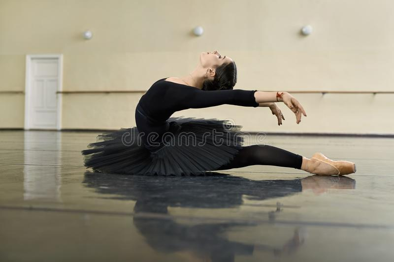 Ballerina posing in dance hall stock photography