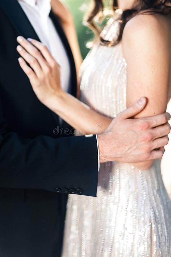 Sensual beautiful bride hugging groom stock image