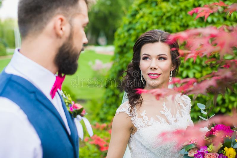Happy married couple in beautiful garden stock photo