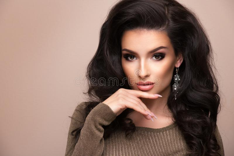 Sensual brunette woman over grey background royalty free stock images
