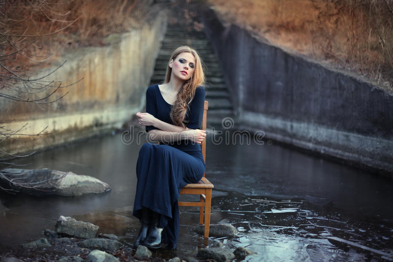 Sensual Beautiful Girl Sitting On Chair Stock Images