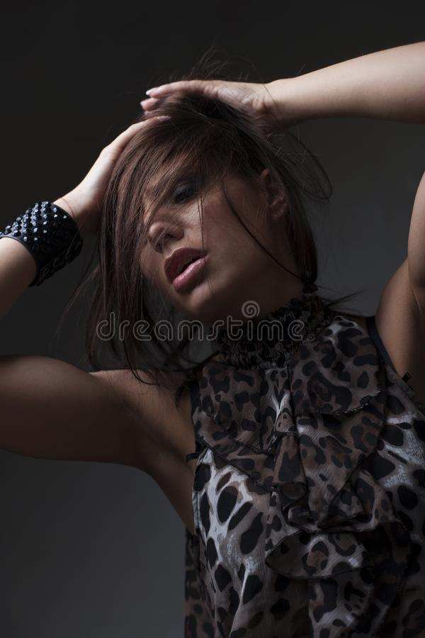 Sensual beautiful young woman in skirt, dark background. Sensual beautiful young woman in skirt, on dark background, looking upwards stock photo