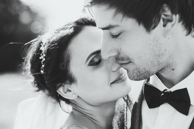 Sensual Black and white portrait of bride and groom. Wedding concept stock photos