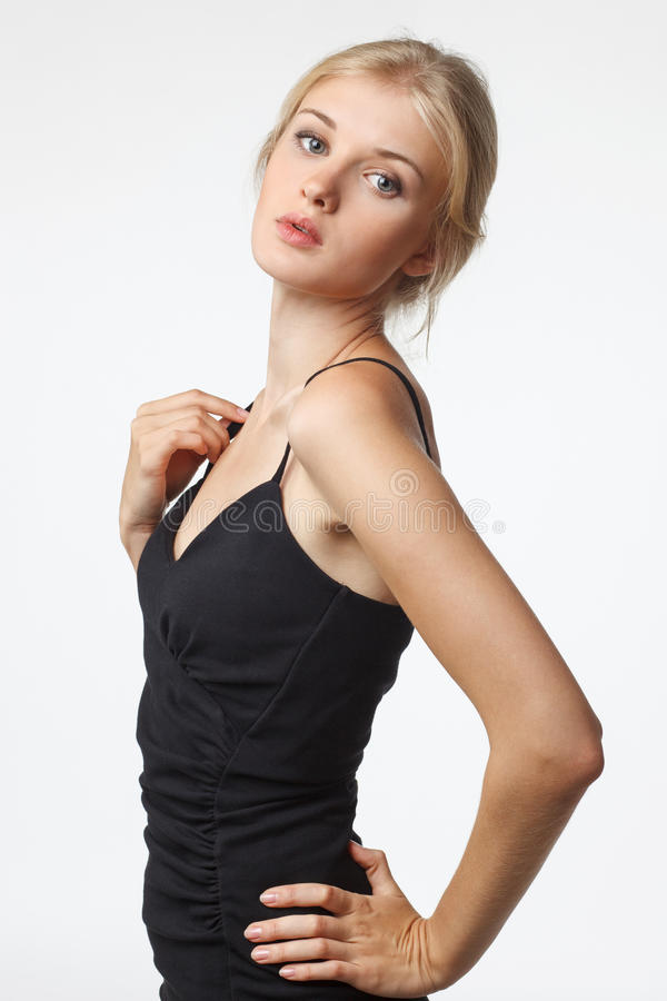 Sensual blond woman in black dress royalty free stock photography