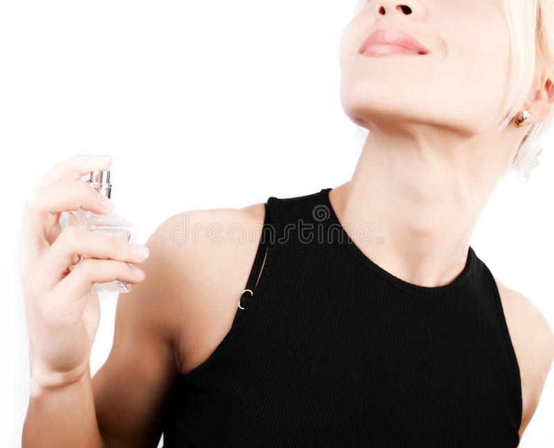 Sensual blonde applying perfume royalty free stock photography