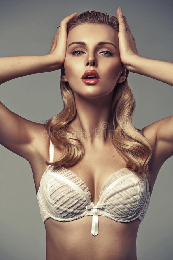 Sensual blonde lady with tempting lips stock photos