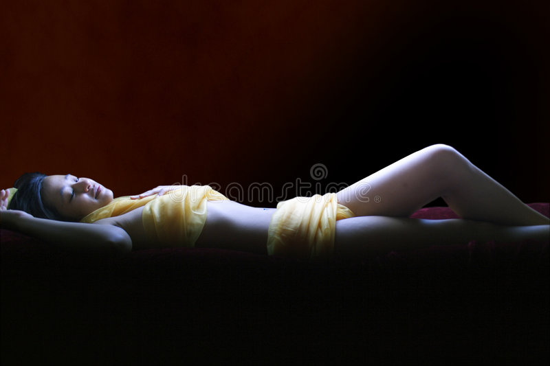 Sensual Body Wrap Spa Treatment Valentine's Day. A young Asian woman with a sensual body wrap, spa treatment -- Valentine's Day