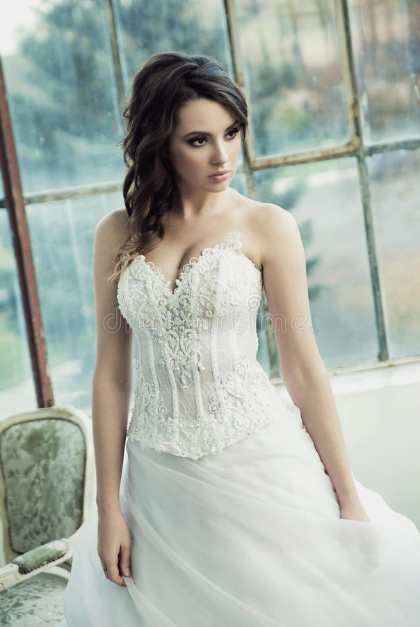 Sensual bride wearing pretty wedding gown stock images