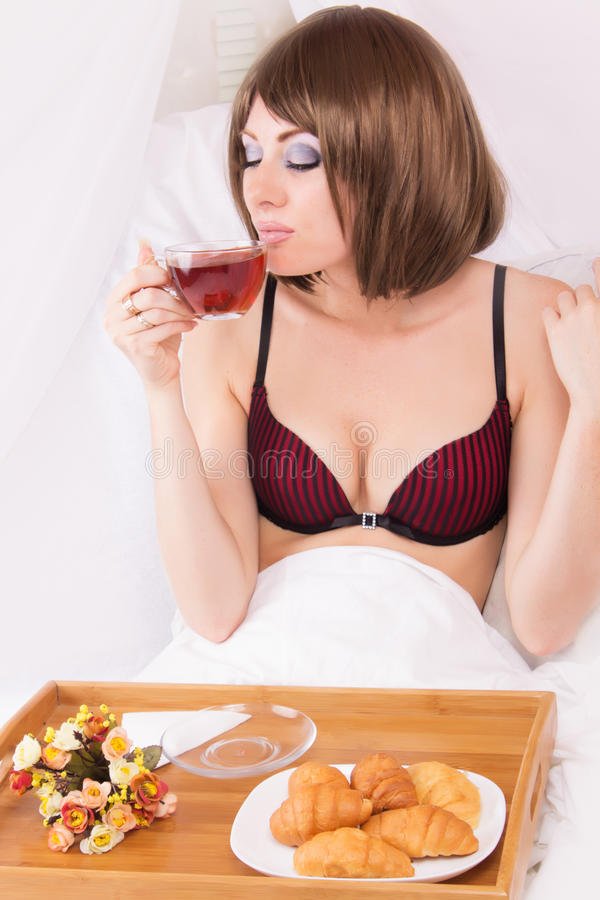 Enjoying morning cup of tea in bed stock photos