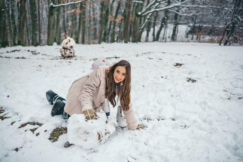 Sensual brunette winter girl posing and having fun. Beautiful young woman laughing outdoors. royalty free stock images