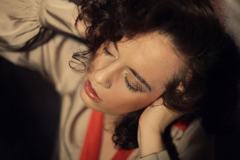 Sensual brunette woman. With shiny curly silky hair studio shot royalty free stock photos