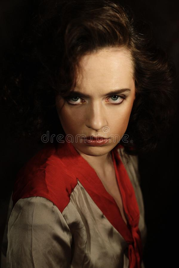 Sensual brunette woman. With shiny curly silky hair studio shot stock photography