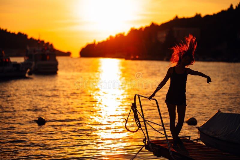 Sensual carefree summer woman enjoying vacation.Seaside stress less lifestyle.Fit traveler enjoying life.Full of energy.Energetic royalty free stock images