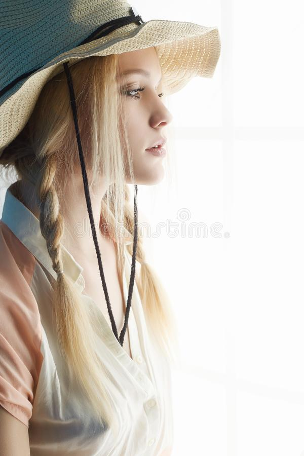 Download Sensual Country Woman In Hat Looking Window Stock Image