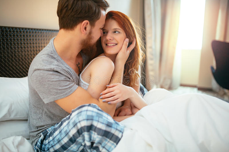 Download Sensual Couple In Bed Being Romantic Stock Photo
