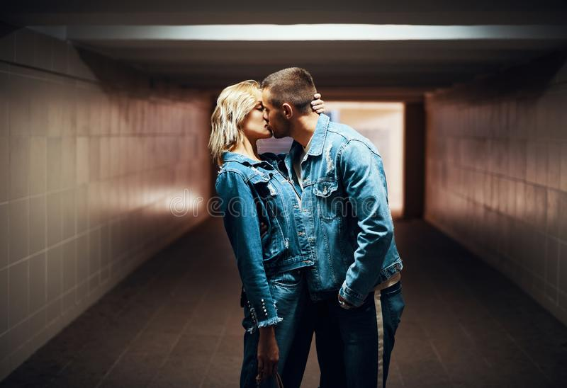 Sensual couple kissing in underground crossing. Love, romantic, passion concept royalty free stock photo