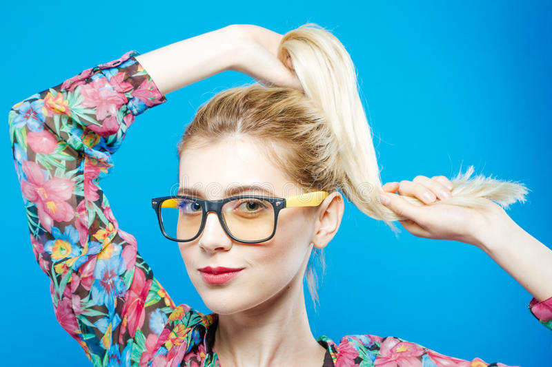 Sensual Cute Girl in Fashionable Eyeglasses is Posing in Studio Looking at the Camera. Portrait of Funny Blonde Woman stock image
