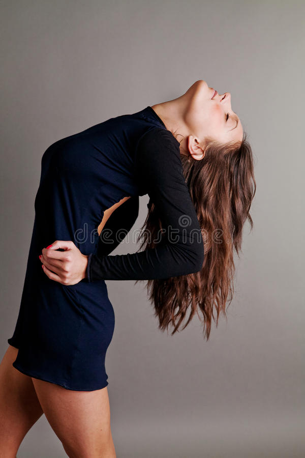 Sensual dance in a black dress stock image