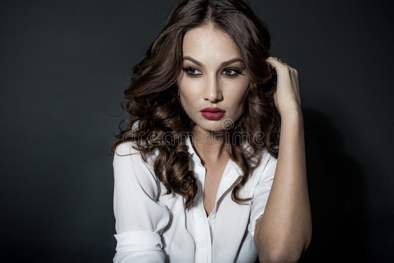 Sensual elegant young woman in black dress royalty free stock photo