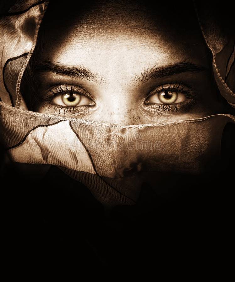 Sensual eyes of mysterious woman. Behind scarf stock images