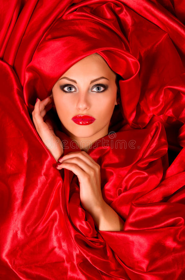 Download Sensual Face  In Red Satin Fabric Stock Image - Image: 27769413