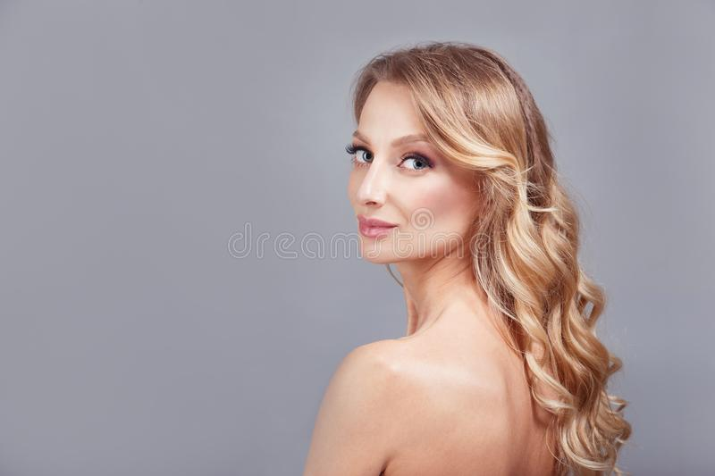 Sensual fashion closeup portrait of young pretty woman blond on gray background. royalty free stock image