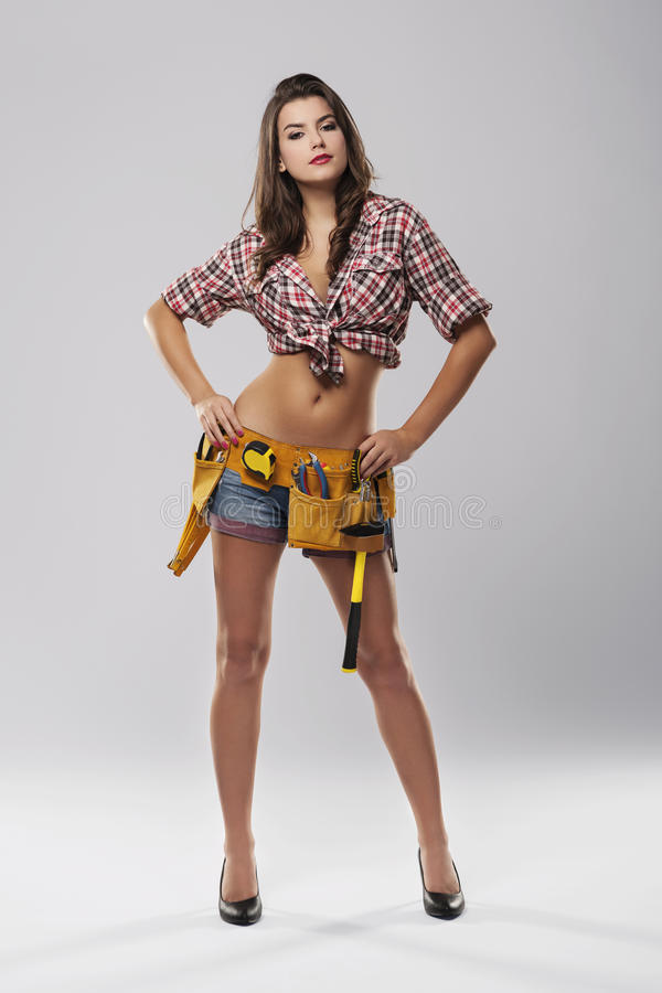 Sensual female construction worker stock photo