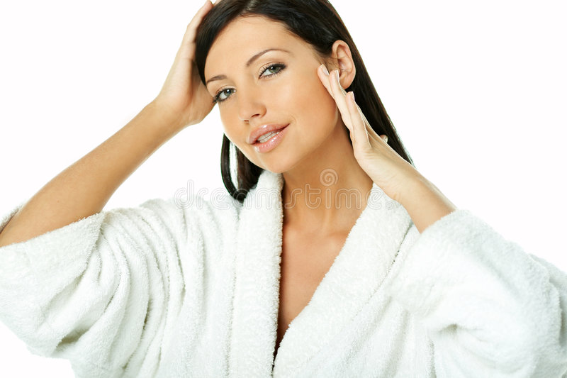 Sensual and Fresh. Portrait of Fresh and Beautiful brunette woman on white background wearing white bathrobe stock image