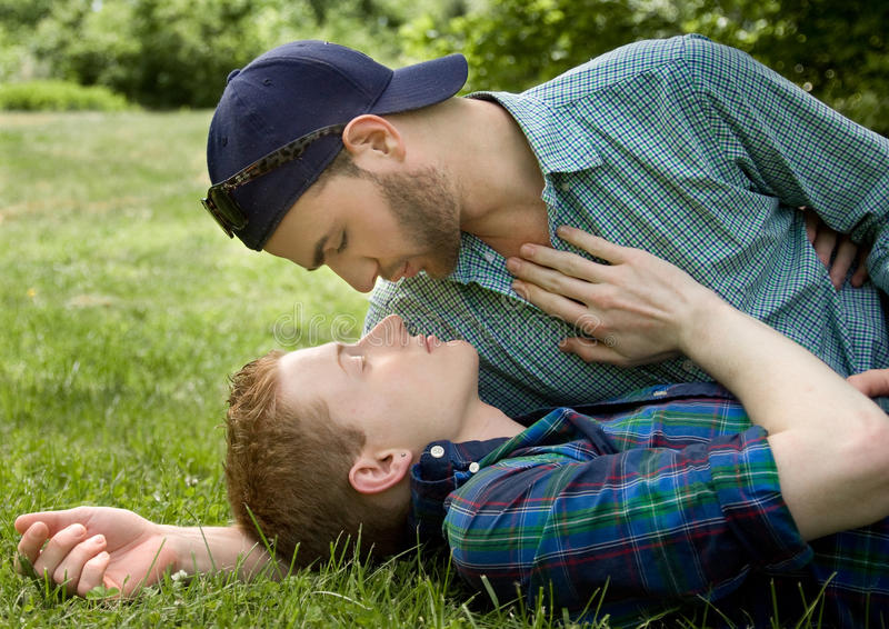 Sensual Gay Couple. An image of a gay couple about to kiss outside stock images