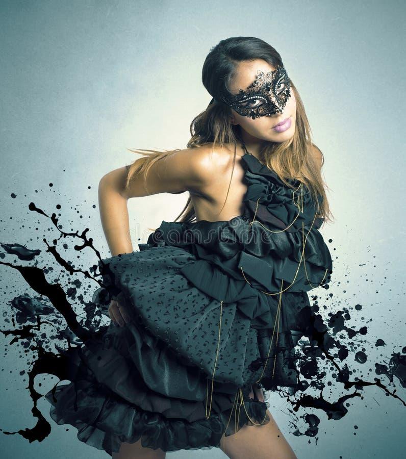Sensual girl in a carnival mask. Sensual dark girl in a carnival mask royalty free stock photo