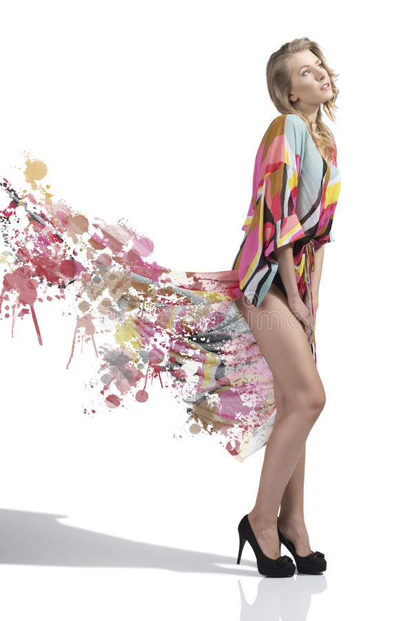Sensual girl with colorful long dress in painting stock images