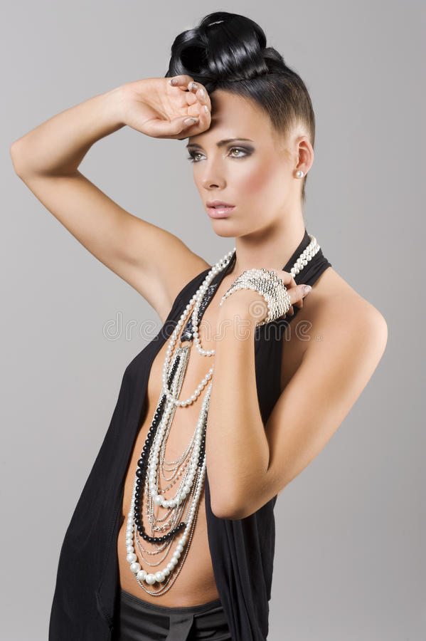 Sensual girl with necklace and hair style stock photo