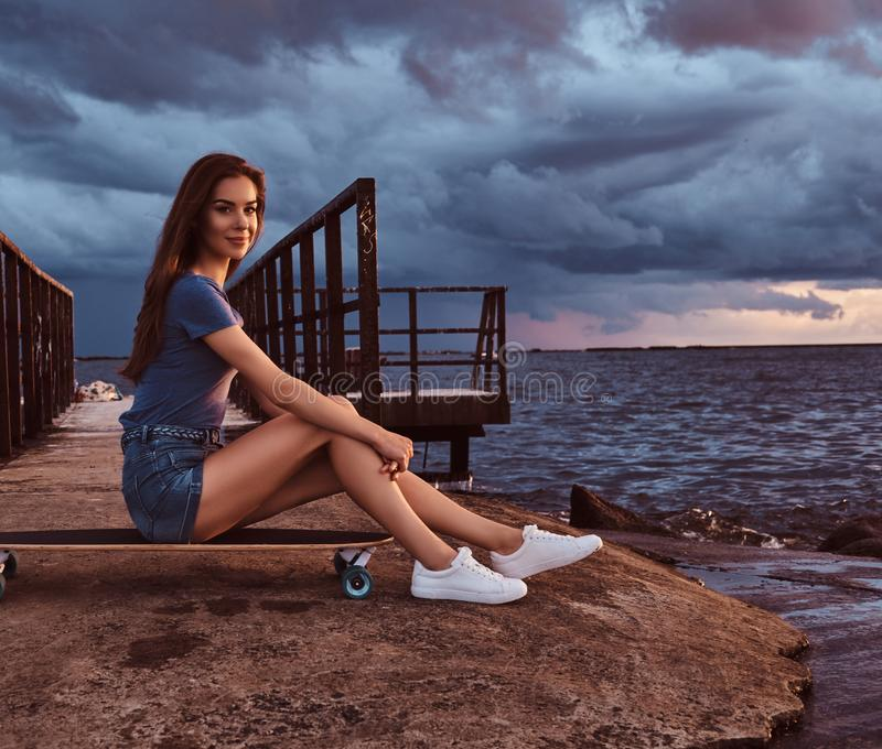 Woman Enjoying At Beach Stock Image Image Of Pleasure: Sensual Girl Sitting On A Skateboard On The Beach Is