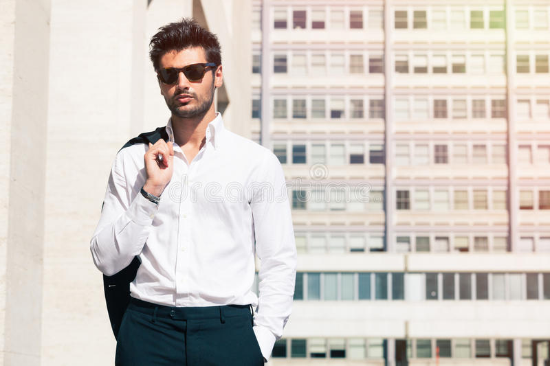 Sensual and handsome young man in the city royalty free stock photos
