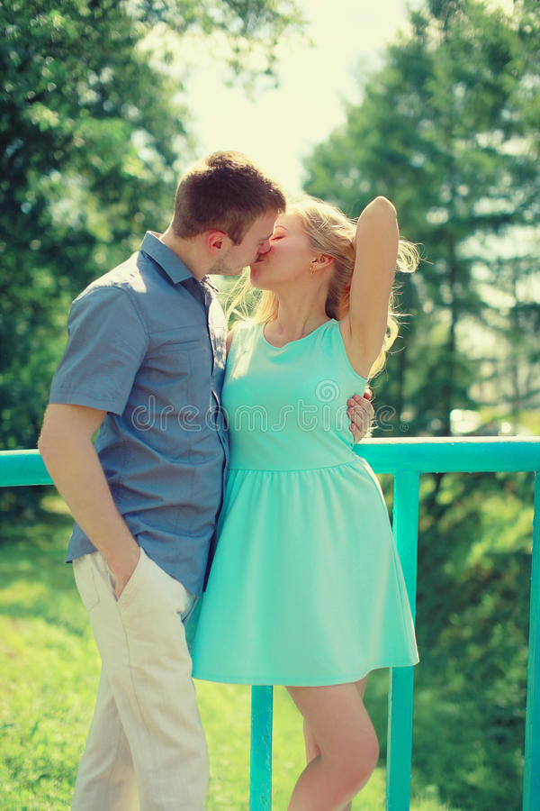 Sensual kiss, couple in love enjoying each other in city royalty free stock photos
