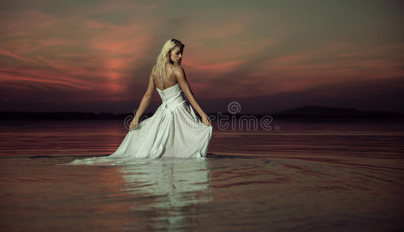 Sensual lady dancing in the water royalty free stock photo