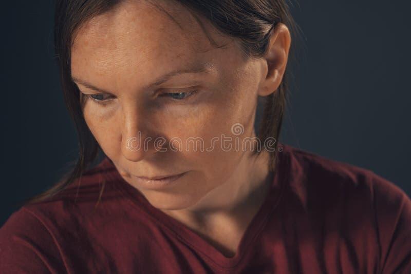 Sensual melancholic female portrait, no makeup and no retouching stock image