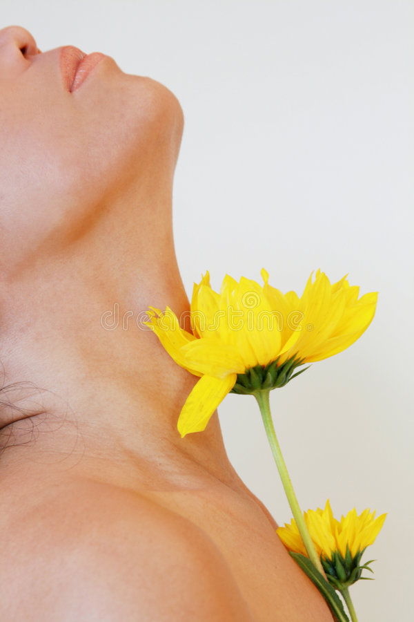 Sensual neck with flowers stock image