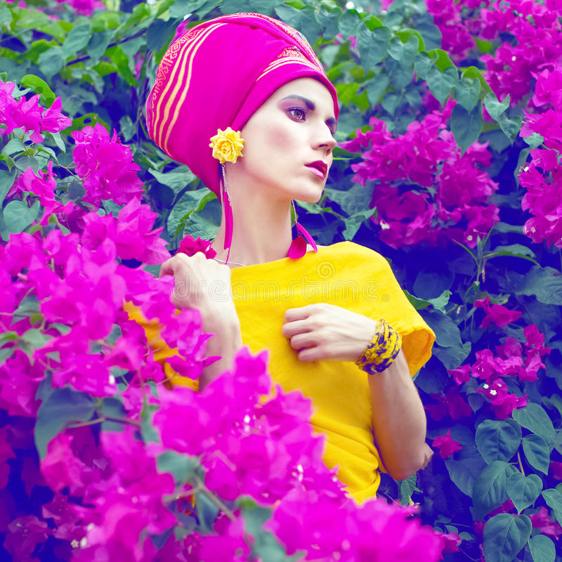 Sensual oriental girl in the flowers royalty free stock image